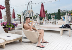 Young Man Relaxing on Deck with Glass of Beer Stock Photos