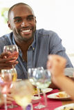 Young Man Relaxing At Dinner Party Royalty Free Stock Photo