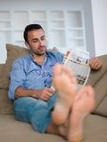 Young man relaxing and dreaming on sofa at home Royalty Free Stock Image