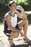 Young Man Relaxing After Exercise And Drinking Water Stock Photos