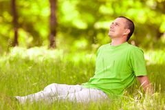 Young man relaxing in the forest Stock Images