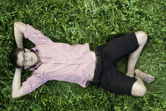 Young man relaxing in grass Royalty Free Stock Photos
