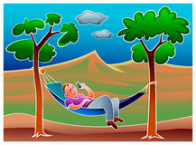 Young man relaxing in hammock in the park Royalty Free Stock Photography