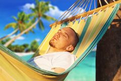 Young man relaxing hanging chair Stock Photo