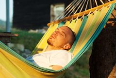 Young man relaxing hanging chair Royalty Free Stock Photography