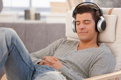 Young man relaxing with headphones Stock Photo