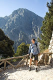 Young man relaxing after a hike in the mountains Stock Photography