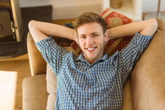 Young man relaxing on his couch Royalty Free Stock Images
