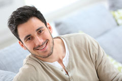 Young man relaxing at home Stock Images