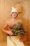 Young Man Relaxing In A Russian Wooden Sauna Royalty Free Stock Photo