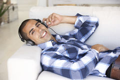 Young Man Relaxing Listening To Music At Home Royalty Free Stock Photos