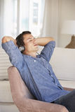 Young Man Relaxing Listening To Music At Home Stock Photo