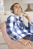 Young Man Relaxing Listening To Music At Home Royalty Free Stock Photo