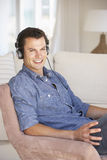 Young Man Relaxing Listening To Music At Home Stock Photography