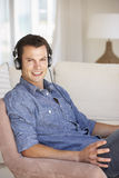 Young Man Relaxing Listening To Music At Home Stock Photos