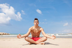 Young man relaxing making yoga Royalty Free Stock Images