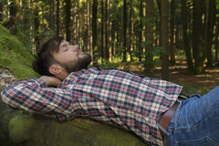 Young man relaxing in nature. Outdoor Shot Royalty Free Stock Image
