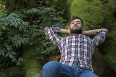 Young man relaxing in nature. Outdoor Shot Stock Photos