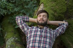 Young man relaxing in nature. Outdoor Shot Stock Photo