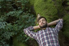 Young man relaxing in nature Royalty Free Stock Photography