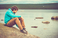 Young Man relaxing outdoor on mountain Royalty Free Stock Images