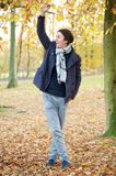 Young man relaxing outdoors on an Autumn day Royalty Free Stock Photography