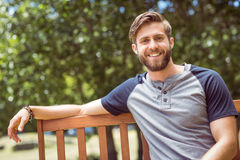 Young man relaxing on park bench Stock Photos