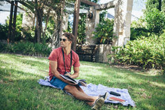 Young man relaxing in park Royalty Free Stock Images