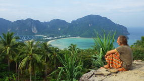 Young man relaxing on a rock in Thailand from Ko phi phi don island viewpoint Stock Images