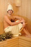 Young man relaxing in a russian wooden sauna Royalty Free Stock Photos