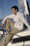 Young man relaxing on sailboat Royalty Free Stock Images