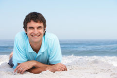 Young Man Relaxing On Sandy Beach Royalty Free Stock Images
