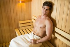 Young man relaxing in the sauna Royalty Free Stock Photos