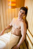 Young man relaxing in the sauna Royalty Free Stock Images