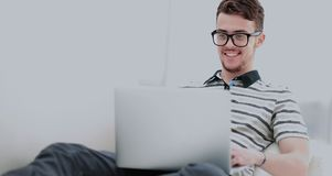 Man Relaxing on Sofa with Laptop Computer Stock Photography