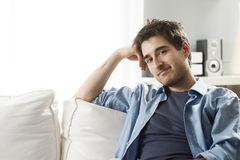 Young man relaxing on sofa Stock Photography