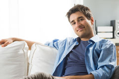 Young man relaxing on sofa Royalty Free Stock Image