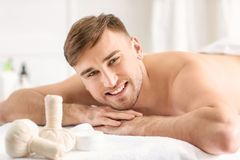 Young man relaxing. In spa salon Royalty Free Stock Photography