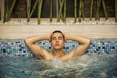 Young Man Relaxing in Spa Whirlpool Stock Photography
