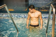 Young Man Relaxing in Spa Whirlpool Stock Image