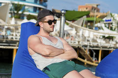 Young man relaxing at the summer beach Stock Images