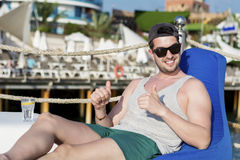 Young man relaxing at the summer beach Stock Image