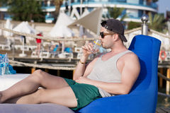 Young man relaxing at the summer beach Stock Photo