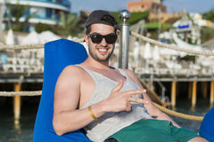 Young man relaxing at the summer beach Royalty Free Stock Photo
