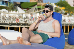 Young man relaxing at the summer beach Royalty Free Stock Image