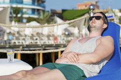 Young man relaxing at the summer beach Stock Photos