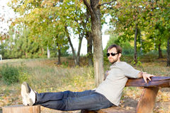 Young man relaxing in the sun Royalty Free Stock Images