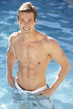 Young Man Relaxing In Swimming Pool Stock Photo