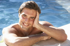 Young Man Relaxing In Swimming Pool Royalty Free Stock Images