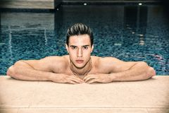 Young Man Relaxing in Swimming Pool Stock Image